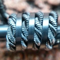Super up close and personal.  2 26n80 clapton with 32n80 and twisted then helixed on one side with 2 30g slightly flattened then filled the grooves of the coil with .8mm ribbon wire.
