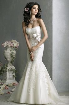 Not the mermaid style, but I love the flow of the dress, the top and the sash. Make it more a-line and it'd be perf.