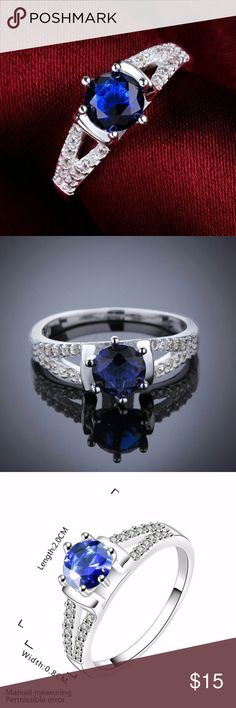 925 STERLING SILVER BLUE SAPPHIRE RING THIS BEAUTIFUL 925 STERLING SILVER FILLED BLUE SAPPHIRE CZECH RING IS A SIZE 8 AND IS NWOT.  MAIN COLOR: SILVER MATERIAL: 925 STERLING SILVER FILLED MAIN STONE: BLUE SAPPHIRE & SWAROVSKI CRYSTAL STYLE: SOLITAIRE WITH ACCENTS RING SIZE: 8 Jewelry Rings