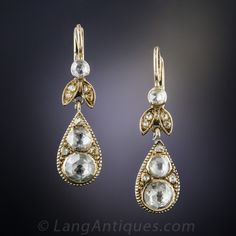 Victorian Rose-Cut Diamond Earrings -10 rose-cut diamonds in each of these foliate style ear drops dating back to the early-to-mid nineteenth century. The pear shape, or tear drop, bottoms are below diamond-set leaves. Rare, wonderful and as sweet as can be. About 1.10 carats total diamond weight,1 and 3/16 inch long from the top of the wire (7/8 inch without).   $3,750.00
