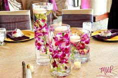Simple and pretty, pink orchids with floating candle