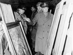 Lt. Gen. Omar N. Bradley, left; Lt. Gen. George S. Patton Jr., center right; and Gen. Dwight D. Eisenhower inspected paintings stored in the...