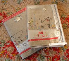 notebooks covered in a textile collage