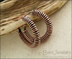 Wire wrapped copper hoop earrings with a post fitting