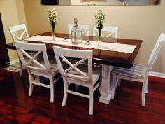 Refinished dining room table. Dark stained top and painted white bottom! Table originally a light brown and chairs were black. We ended up spray painting them. Turned out great!