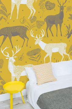 Looking for something a bit different? This beautiful pattern wallpaper design shows a fun and lively print of illustrated deer. White and grey deer look around curiously against a mustard yellow background. This wallpaper print is perfect for kid's bedrooms and has a lovely yet contemporary feel.