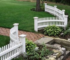 Fences and flowers can make a big impact on curb appeal...I'd like to add just a curved wrought iron fence like this and some plants to frame the entrance at the end of the sidewalk of the 1890s house.