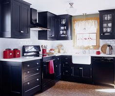 Dose-of-Drama Kitchen:This small kitchen aims to be big with dramatic flourishes of black cabinets, a contrasting white subway tile backsplash, and unique cork flooring. Plenty of planning, down to every detail of the pantry, also makes this kitchen a star.