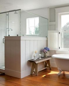 I like the shower enclosure paneled in wood to chair-rail height. It lends a little privacy while still allowing all of the light throughout.  Master bath in modern barn home; D. Michael Collins