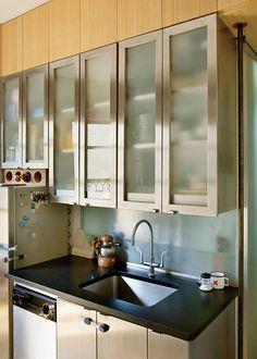 Translucent Panelite cabinets brighten this compact kitchen.