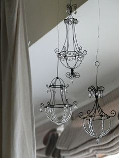 Mini wire chandeliers (would look nice as a planter also)