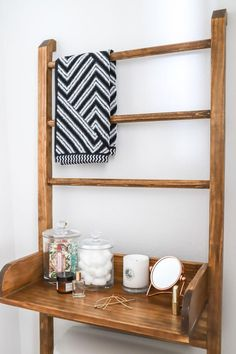 Make the most of a small bathroom with this DIY leaning ladder shelf and towel rack. Designed to fit over the toilet, this sleek storage piece won't damage your walls, so it's perfect for renters.