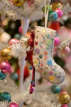 felted stocking.  How cute would this ornament be with vintage buttons from Grandmother's button box.