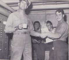 Uncle Herb in the Yeoman's office onboard USS Makassar Strait (CVE-91) during World War II. He is the one in the back right side.