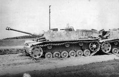 A late model of StuG 40 Ausf. G with extra armor plates over superstructure knocked-out by advancing Soviet troops.