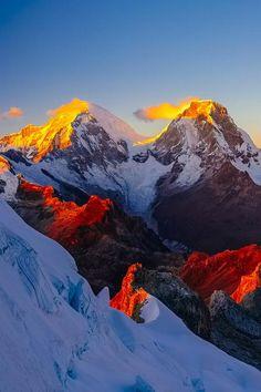Sunlight hitting the peaks.