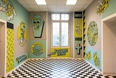 inside an old dentist's school in rennes, france, freak city has completed an immersive mural that express the duality between technology and humanity.