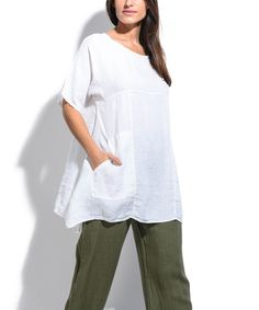 Angular side slits put a trend-right spin on your look, and lightweight linen in a breezy cut ensures all-day comfort. Size note: This item runs in European sizing. Please refer to the size chart. Shipping note: This item is shipping internationally. Allow extra time for its journey to you.