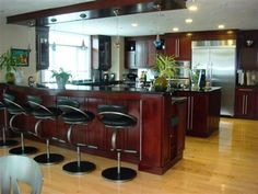 Check out this Luxury kitchen for entertaining! See more Luxury properties like this one on LuxuryHomes.com!