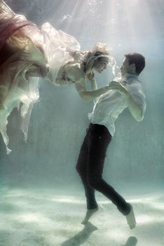 Photographer: Ela Wlodarczyk Designer: Isla Campbell Models: Jennifer Ivey and Adam De La Mare. (dancing underwater.. The next level)