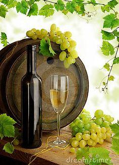 Wine still life with grapevine by Michaela Stejskalova, via Dreamstime