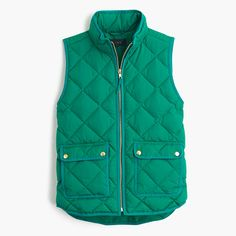 "A lightweight down vest that's compact and easy to layer but still warm enough to keep chilly weather at bay. We made the sporty shape a bit more flattering with a slimmer silhouette and gold hardware. <ul><li>Boxy fit.</li><li>Body length: 24 1/2"".</li><li>Hits at hip.</li><li>Down-filled poly.</li><li>Pockets.</li><li>Machine wash.</li><li>Import.</li></ul>"