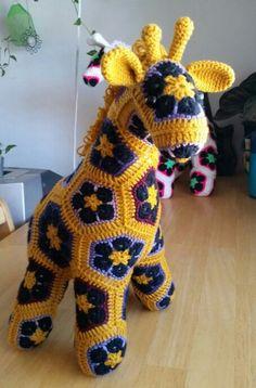 My 5th giraffe, so dang cute!! Pattern by Heidi Bears. Crochet giraffe with African flower motifs.