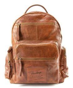 Love this Cognac Rugged Leather Backpack made by Rawlings (the baseball glove people) 299.99 This is gorgeous.