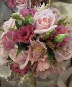 `Bianca Candy` roses, blushing bride, pink lisianthus, pieris