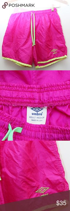 "90's Vintage ""UMBRO"" Nylon Athletic Shorts Rare 90's Vintage ""UMBRO"" Nylon Logo Athletic/Running Shorts (Women's Exclusive)  - Marked Size: MEDIUM - Material: 100% NYLON - Condition: VERY GOOD - Color: PINK & GREEN  Measurements: (IN INCHES)  Waist: 26-34"" Length: 15.5"" Inseam: 6"" Hips: N/A Bust: N/A ARMPIT TO ARMPIT: N/A Bust (2x): N/A SHOULDERS (SHOULDER TO SHOULDER): N/A SLEEVE: N/A  ***ONLY 1 AVAILABLE IN ALL OF OUR STORES*** Umbro Shorts"
