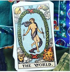 Real life tarot images of thewildgreenwoman instagram The World.