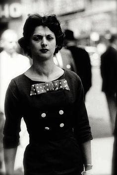 Woman in a bow dress, New York City, 1956. Photo by Diane Arbus.