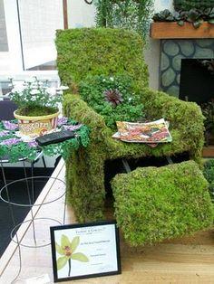 grass/moss covered chair