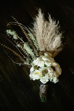 Wild Bohemian Bridal Bouquet with Feathers ..I like parts of this