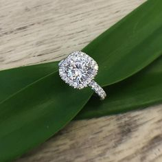 An elegant cushion halo engagement ring is sure to make people stop and stare. Ring by Michael M.