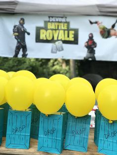 Supply drop Fortnite party favor bags. Super easy. Tucked in the front handle and taped the back one to the balloon. Used sharpie for design- didn't have time to be more creative.