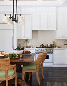 The kitchen's Melina dining chairs and Paul Ferrante Charlotte chandelier are from Holly Hunt.