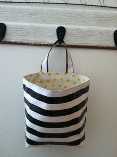 **oilcloth bag!** Hey, I found this really awesome Etsy listing at http://www.etsy.com/listing/108188071/beths-oilcloth-car-trash-bag