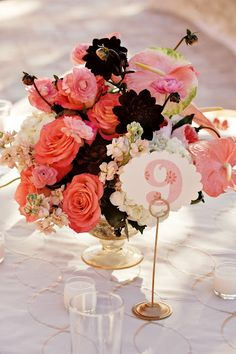 Pretty color combo: Chocolate Cosmos, pink Anthyrium, coral Roses, Ranunculus and Peach Stock.