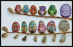 Painted stones.   Branches of various well painted owls.