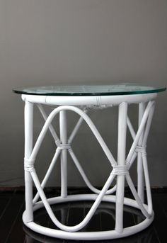 pair of white rattan side tables