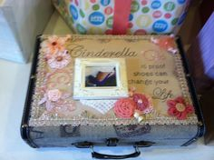 Baby gift package - small suitcase with tea dyed pained canvas blinged out with stones, framed photo of mother's wedding shoe (my dau in law) small piece of my wedding dress, filled with baby shoes a small photo of baby's name-sake and a baby pillow case that belonged to me.  Baby due anyday.