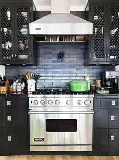 Tom Filicia's kitchen at his weekend home . I'm not courageous enough to tackle black, but I do love this look, especially the chicken-wire cabinets fronts. New Kitchen, Kitchen Dining, Kitchen Decor, Kitchen Cabinets, Kitchen Ideas, Black Cabinets, Kitchen Magic, Upper Cabinets, Kitchen Styling