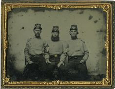 Three members of the Sussex Light Dragoons (5th Virginia Cavalry) by an unknown Southern photographer.    From the Museum of the Confederacy Collection, Richmond, VA.
