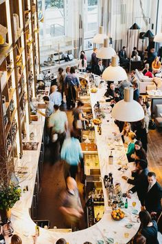 St.Cecilia an Atlanta based restaurant, showcases stunning interiors by Meyer Davis Design studio. Love the gorgeous marble topped bar, subway tiled columns, brass trimmings, beautiful reclaimed wood flooring, enormous windows & industrial style lighting .. & what a cool bathroom | 1-8 by andrew thomas lee photograpy. x debra follow on bloglovin'