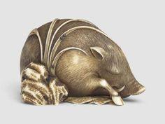 Ivory netsuke of a sleeping wild boar, Edo period