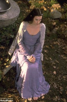This is a lovely beaded periwinkle (or lavander) gown that Arwen wears in a sequence that was cut from either The Lord of the Rings: The Two Towers or The Lord of the Rings: Return of the King.