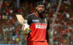 Chris Gayle shows the victory symbol after a successful IPL bid