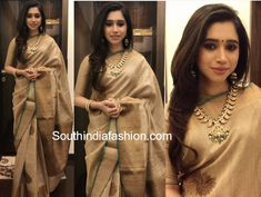 Aarti Ravi attended a wedding in Chennai recently wearing a traditional silk saree paired with matching elbow length sleeves high neck blouse by Mokshaa Indian Party Wear, Indian Wear, Golden Saree, Bridesmaid Saree, Sangeet Outfit, Traditional Silk Saree, Saree Models, Latest Designer Sarees, Saree Look