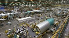 Boeing's factory at Everett, near Seattle, is the largest building in the world, as befits the world's biggest planemaker. Big Building, Eye Of The Storm, Spacecraft, Seattle, Aviation, Cruise, Aircraft, Around The Worlds, Business